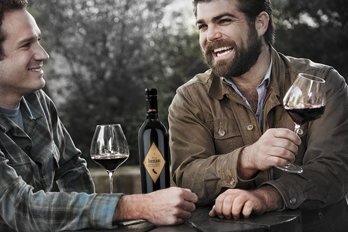 Beran rustic lifestyle image featuring Joe Wagner and friend - bottle of Beran wine and two wine glasses