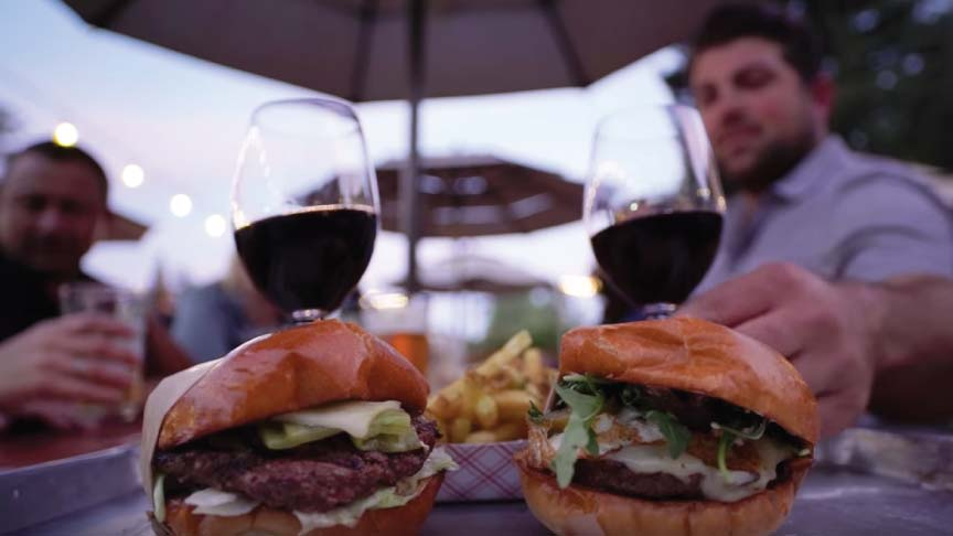 Copper Cane Go with your Palate - two burgers and two wine glasses with Joe Wagner and friends