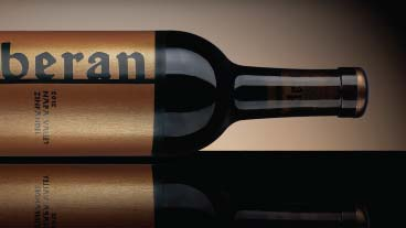 Moody horizontal bottle shot with Beran wine label