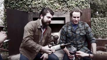 Go with your palate, sizzle video image - Joe Wagner pouring a glass of wine among friends